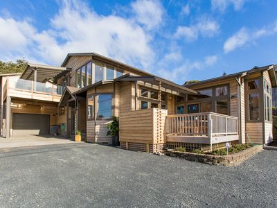 Photo for Premier beach house with massive hot tub, in-house sauna & luxurious amenities!