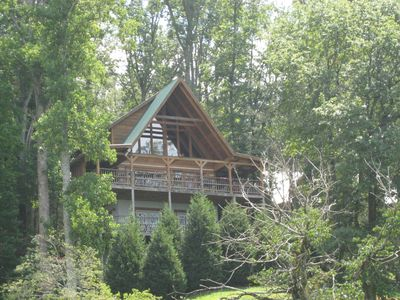 Nature's Dream, a luxury cabin, nestled on a landscaped hillside beside the Park
