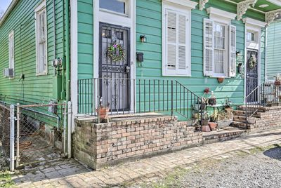 This home is situated a short walk from Magazine Street and streetcar lines.