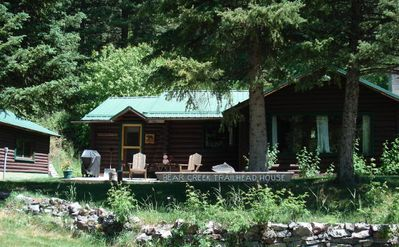 The creek side cabin in a secluded forest setting at the trail head.