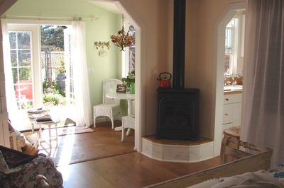 Great gas fire heating stove.  Peak of kitchen and garden nook with dining table