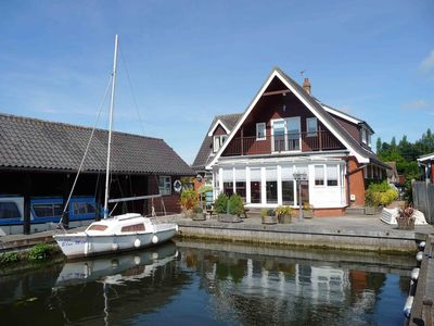 Photo for Self Catering 5 Bedroom Waterside Retreat Cottage Wroxham, Norfolk Broads, Eng