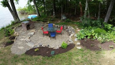 River rock patio with wood-fired grill
