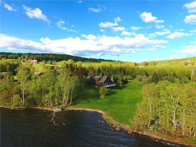 Photo for Home on Rangeley Lake with beach area, and large lawn for outside games and fun!