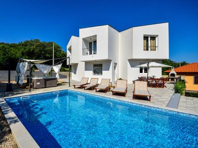 Photo for This 3-bedroom villa for up to 8 guests is located in Dobrinj and has a private swimming pool, air-c