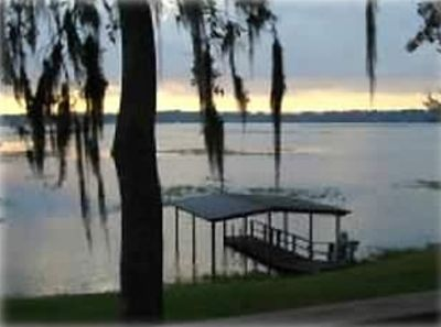 Photo for Lake Front House with Covered Boat Dock, Great Fishing, Pets, internet, canoe