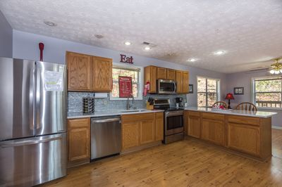 Stainless appliances and quartz countertops.