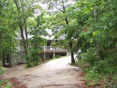 Riverfalls Hideaway II nestled among the towering trees of the Ozark mountains.