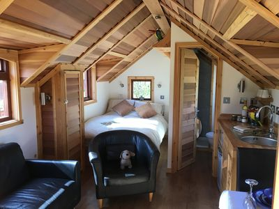 Lodge interior, looking towards bed & bathroom