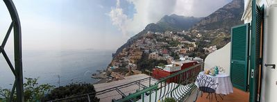 Photo for Villa Faustina D: A splendid and luminous apartment overlooking the sea and the main beach of Positano.