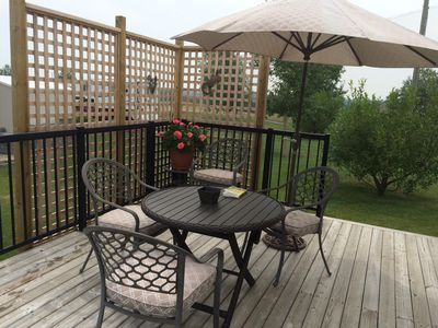 Patio furniture and back deck screen facing 9th fairway