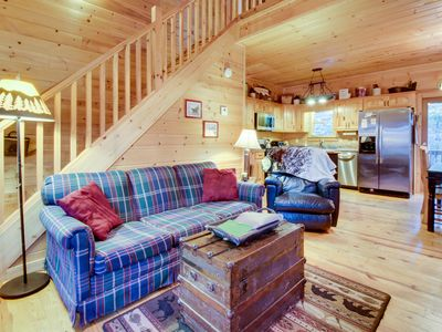 Photo for Dog-friendly forest cabin with a hot tub, shared pool, game room, two decks