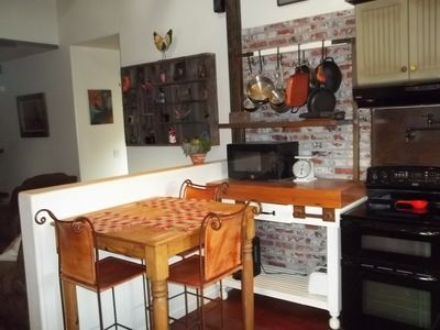 Dining table located in kitchen for a relaxed casual experience