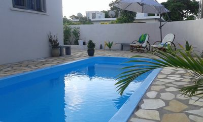 Photo for Sunny private FIRST floor 1-br beach apartment with spacious balcony, pool, WIFI