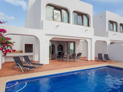 Photo for Modern villa on a small complex w/ private terrace, pool + sea views