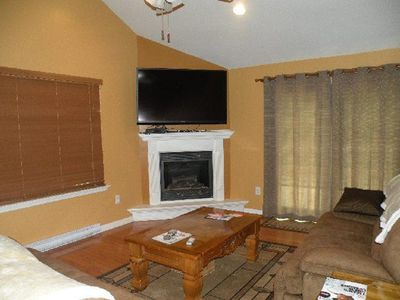 propane fireplace with remote ,flat screen tv.,sectional sofa with elect.lounges