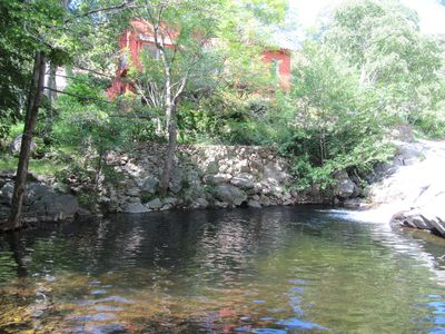 Photo for 2 bed apartment, natural pool in quiet stunning streamside location near the sea