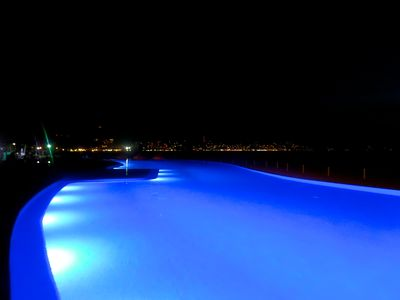 Pools Lit up at night  Partial View of Downtown   The Best Views on the Ocean!