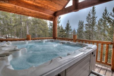 Covered hot tub with views