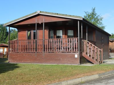 Photo for 1 Arnside is a cosy comfortable lodge with spectacular views of the lake