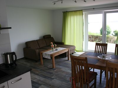 Photo for Kaminträume directly on the water - sea view holiday house with 2 apartments in Neuendorf / Rüg