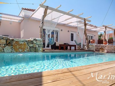 Photo for New luxury villa with private pool a few steps from the sandy beach.
