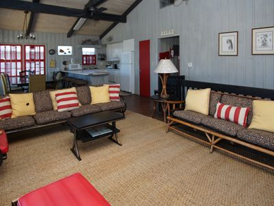 Photo for Relax outside on the shaded ground-level patio or upstairs on the extra large sundeck