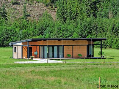 Photo for Modern and luxurious design home at the edge of a forest and a stream