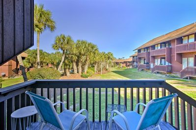 This condo boasts a private balcony looking out onto Lanai Village.