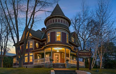 Queen Anne Victorian Mansion featuring wrap-around porch and regal entrance