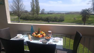Photo for T2 renovated sea view, quiet 50m from the beach, Clim Wifii Private parking, swimming pool