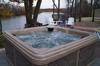 Private Hot Tub next to the Cedar River and your own fire pit