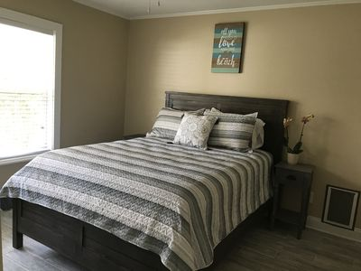 Lots of natural light in this queen bedroom with doggie door and large closet