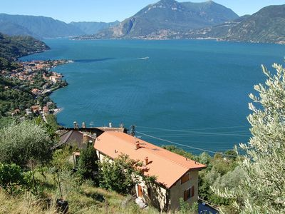 Photo for Two bedrooms and two bathrooms stunning lake Como views, balcony, garden, pkg