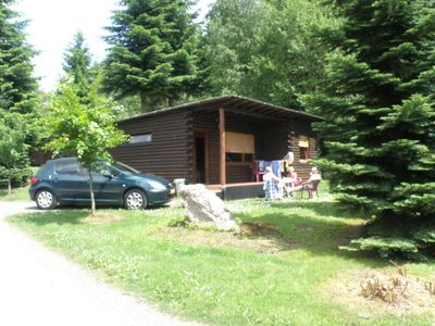 Photo for Tidy furnished wooden chalet, located close to the forest