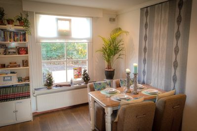 Stylish dining area, laptop space & children's highchair provided when needed.