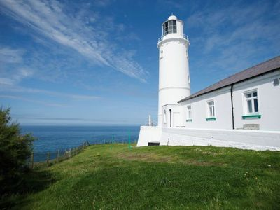 Photo for Pelorus Cottage at Trevose Head Lighthouse is located on a headland between sandy beaches.