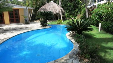 Photo for Holiday villa with pool and tropical garden on the beach of Surfers Paradise Cabarete