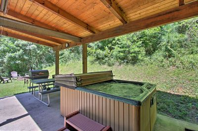 Your group is sure to love the hot tub and covered patio.