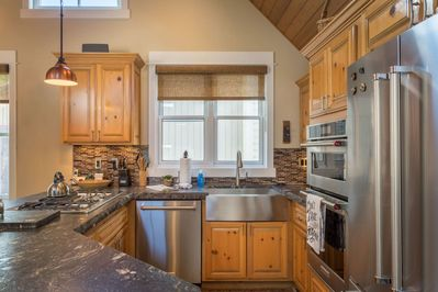 Fully-equipped kitchen with breakfast bar seating