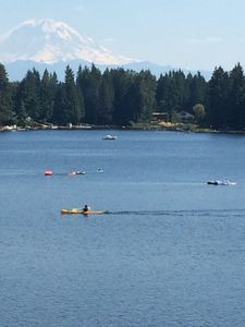 Kayaks and paddleboards on the lake with Mt Rainier in the background