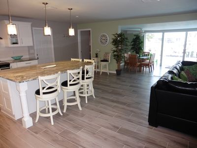 Featuring large sliding glass doors to access pool & patio area.