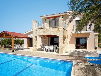 Photo for Secluded villa with stunning sea-views, pool and Wi-Fi, close to busy resort