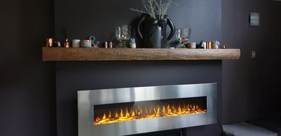 Electric flame effect fire heats in winter & runs on cold for summer ambiance