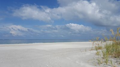 Photo for A Cozy Beach Retreat just a minute walk to the soft sands on the beach..........