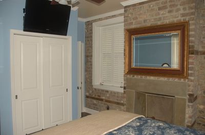 "Bedroom with decorative fireplace, large closet & 37"" HDTV"