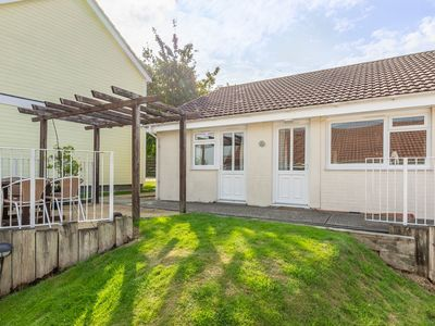 Photo for Two-bedroom cottage located close to the tennis courts, perfect for the family.