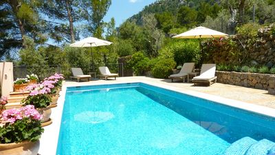 Heated swimming pool with views of the mountains and sea