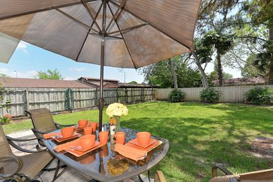 Outdoor dining with beautiful oversized fenced back yard for privacy and fun