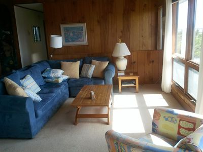 Living room with large windows for viewing water and Nature Preserve.